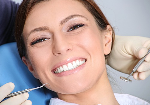 Woman receiving emergency dentistry treatment