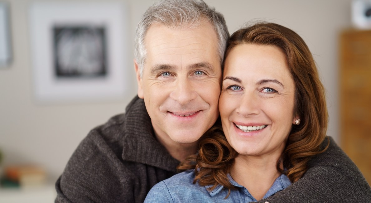 Older couple sharing healthy smiles