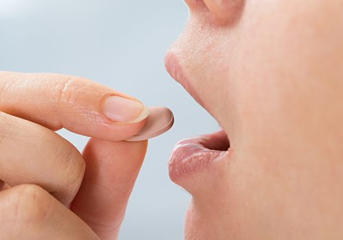 Patient taking oral conscious sedative pill