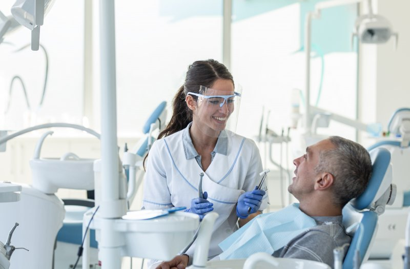 Dentist in San Antonio wearing PPE with patient